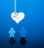 Love. Two blue wooden icons on a blue background with a heart overhead. Could represent a homosexual couple in love or a wedding stock image