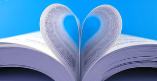Love. Pages of a book curved into a heart shape Stock Image
