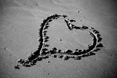 Love. Heart Carved in the Sand Stock Images