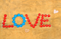 Love. Word ''love'' on brown background stock images