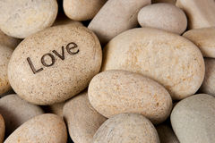 Love. Stone with engraved Love word on rock background Stock Image