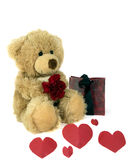 Love.... Cute fluffy teddy holding a red carnation and with hearts and gift bag Stock Photography