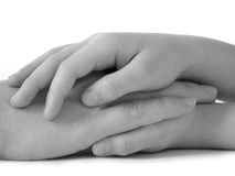 Love. Mother hand in daughter's ones Stock Images