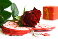 Love. Red rose on heart-bag. Present behind rose Royalty Free Stock Photography
