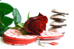 Love. Red rose on heart-bag. Four cakes are behind rose Royalty Free Stock Photos