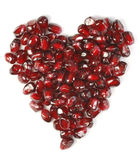 Love. Heart shaped pomegranate seeds, high key, vivid and detailed Stock Image