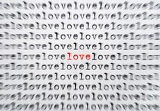 In Love. Words love written with an old typewriter, one word written in red and standing out, the rest blured out Royalty Free Stock Photo