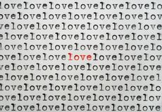 Only Love. Words love written with an old typewriter, one word written in red and standing out royalty free stock photography