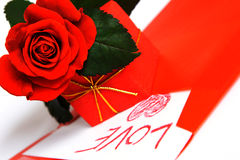 Love. Red rose, red gift and red envelope with love letter Stock Photos