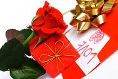 Love. Valentine Day: red rose, red gift and red envelope Royalty Free Stock Photo