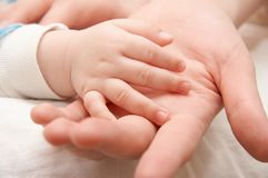 Love. The hand of the child gently lays in a hand of mother royalty free stock photography