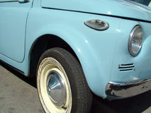Love 500. Closeup of a first model of Fiat 500 headlight, indicator and Original tyre royalty free stock photos
