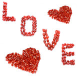 Love. Red pomegranate hearts and love Stock Images