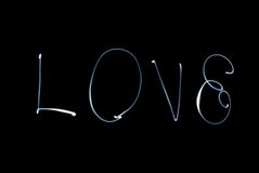 Love. Word love on a black background Stock Images