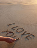 Love. Writing I love you on the sand royalty free stock images