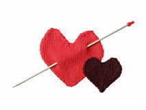 Love. Two knitted hearts on the white background Stock Images