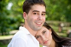 Love. Portrait of a young couple in love at the park stock image
