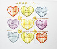 Love is. Something which write in each heart shape Stock Image