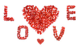 Love. Red pomegranate letters and hearts Royalty Free Stock Images