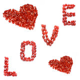 Love. Red pomegranate letters and hearts Stock Photos