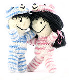 Love. Cute handmade crochet dolls hugging one another royalty free stock images