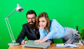 Love affair at work. Seduction. corporate ethics. businessman and assistant. sexy woman and man work in office at laptop. Love affair at work. Seduction royalty free stock photos