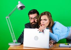 Love affair at work. Seduction. corporate ethics. businessman and assistant. woman and man work in office at laptop. Love affair at work. Seduction. corporate royalty free stock image