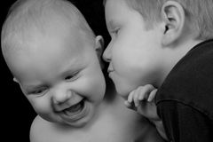 Love and Affection. Boy kissing sister Stock Images