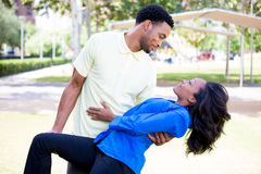 Love and affection. Closeup portrait of a young couple, guy holding women in arms in dip, looking at each other, dance pose, love and romance concept, positive Royalty Free Stock Photo