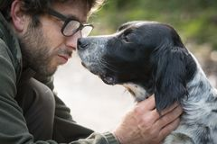 Love and affection between man and his dog. In the woods Stock Photography