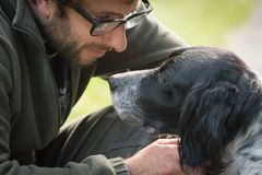 Love and affection between man and his dog. In the woods Royalty Free Stock Images
