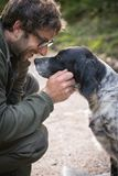 Love and affection between man and his dog. In the woods Royalty Free Stock Photos