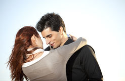 Love and affection between a young couple. In outdoor (selective focus with shallow DOF Royalty Free Stock Images