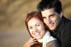 Love and affection between a young couple. In outdoor (selective focus with shallow DOF Stock Photography