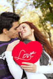 Love and affection between a young couple. At valentine day (selective focus with shallow DOF Royalty Free Stock Photos
