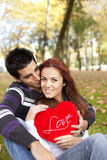Love and affection between a young couple. At valentine day (selective focus with shallow DOF Stock Images
