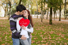 Love and affection between a young couple. At valentine day (selective focus with shallow DOF Stock Image