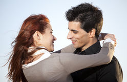 Love and affection between a young couple. In outdoor (selective focus with shallow DOF Stock Images