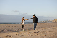 Love and affection between a young couple. In outdoor (selective focus with shallow DOF Royalty Free Stock Image