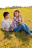 Love and affection between a young couple. At the park in autumn season Stock Image