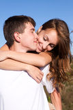 Love and affection between a young couple. At the park Stock Image