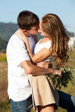 Love and affection between a young couple. At the park in autumn season Royalty Free Stock Photo