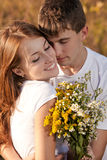 Love and affection between a young couple. At the park in autumn season Stock Photo