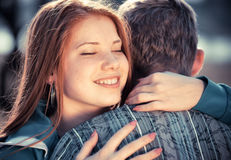 Love and affection between a young couple. At the park Royalty Free Stock Images