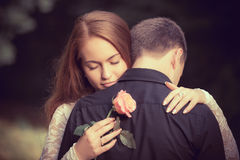Love and affection between a young couple. At the park Royalty Free Stock Photo