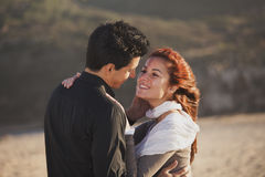 Love and affection between a young couple. At the beach in sunny day (selective focus with shallow DOF Stock Image