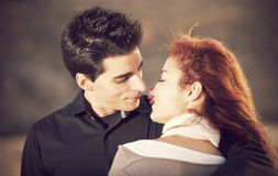 Love and affection between a young couple. At the beach in sunny day (selective focus with shallow DOF Royalty Free Stock Image