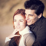 Love and affection between a young couple. In outdoor (selective focus with shallow DOF Stock Photo