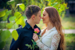 Love and affection between a young couple. At the park Royalty Free Stock Photography