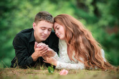 Love and affection between a young couple. At the park Stock Images